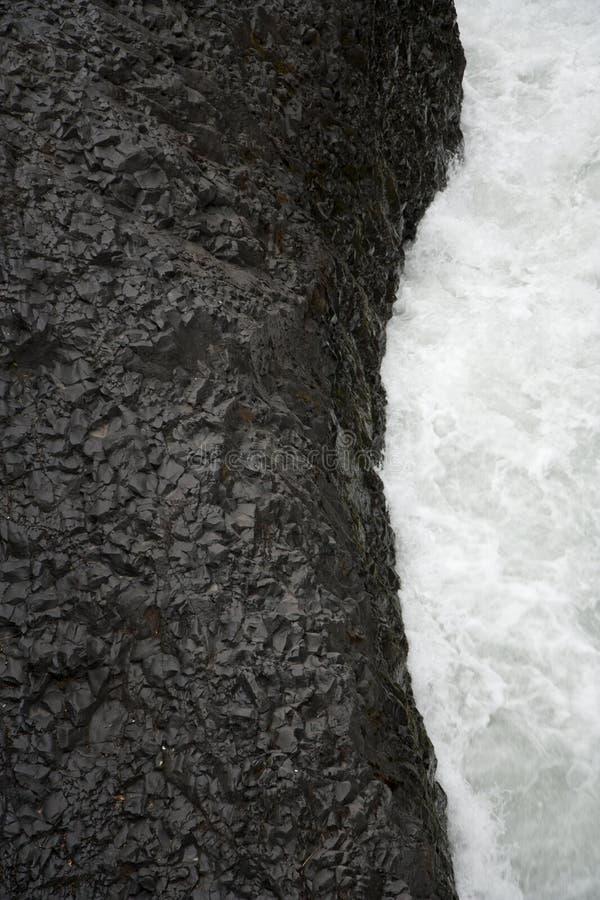 Lava preta e água branca fotografia de stock royalty free