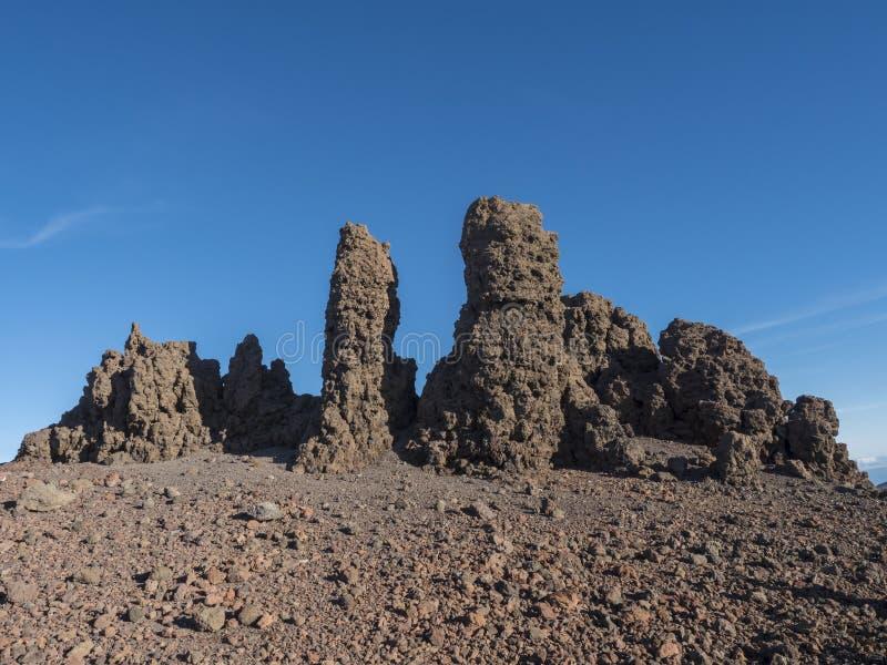 Lava rock formation at top Roque de los Muchachos mountain peak in Caldera Taburiente La Palma at Canary Islands. Blue sk backgorund stock images