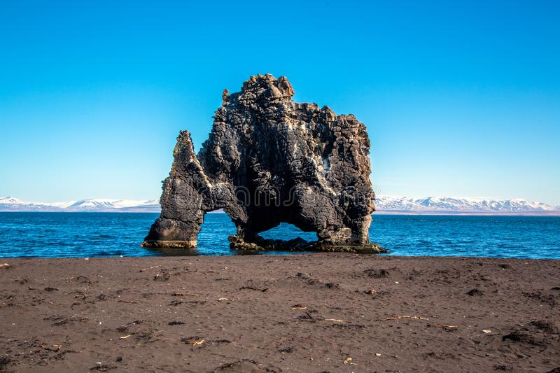 Lava rock formation with Trollsaga. In front of Icelandic scenery stock image