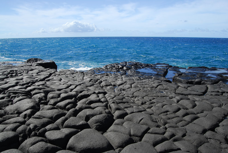 Lava rock and ocean in Hawaii stock photo