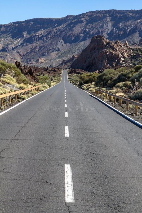 Lava rocks and road to the volcano Teide on Tenerife stock photos