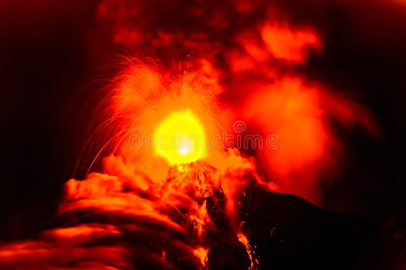 Lava spurts from erupting Fuego volcano in Guatemala. Fuego volcano erupts in the early hours on November 19, 2018 near Antigua, Guatemala, Central America. Slow royalty free stock photography