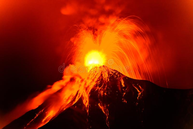 Lava spurts from erupting Fuego volcano in Guatemala. Fuego volcano erupts in the early hours on November 19, 2018 near Antigua, Guatemala, Central America. Slow royalty free stock photos