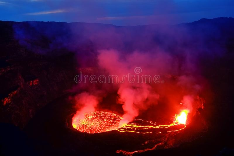 Lava and steam in crater of Nyiragongo volcano in Virunga Nation royalty free stock images