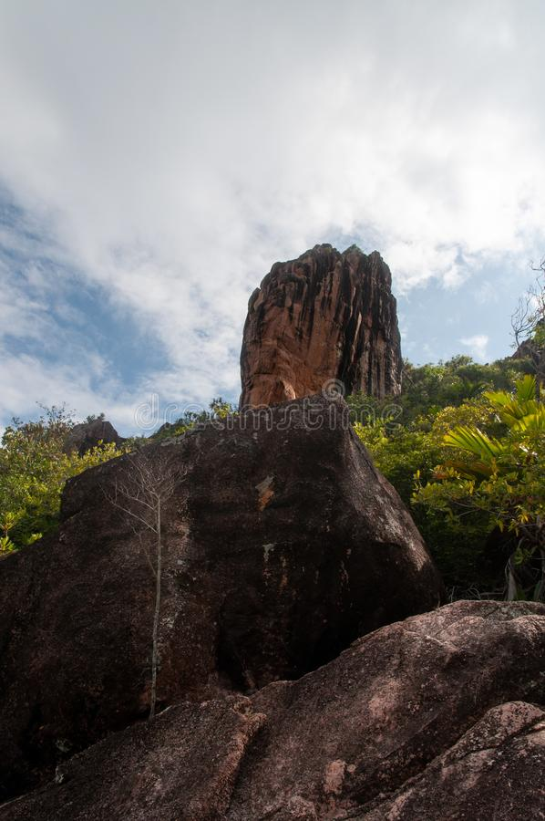 Lava stone formation, monolith, in the natural park of curieuse island, Seychelles royalty free stock photos