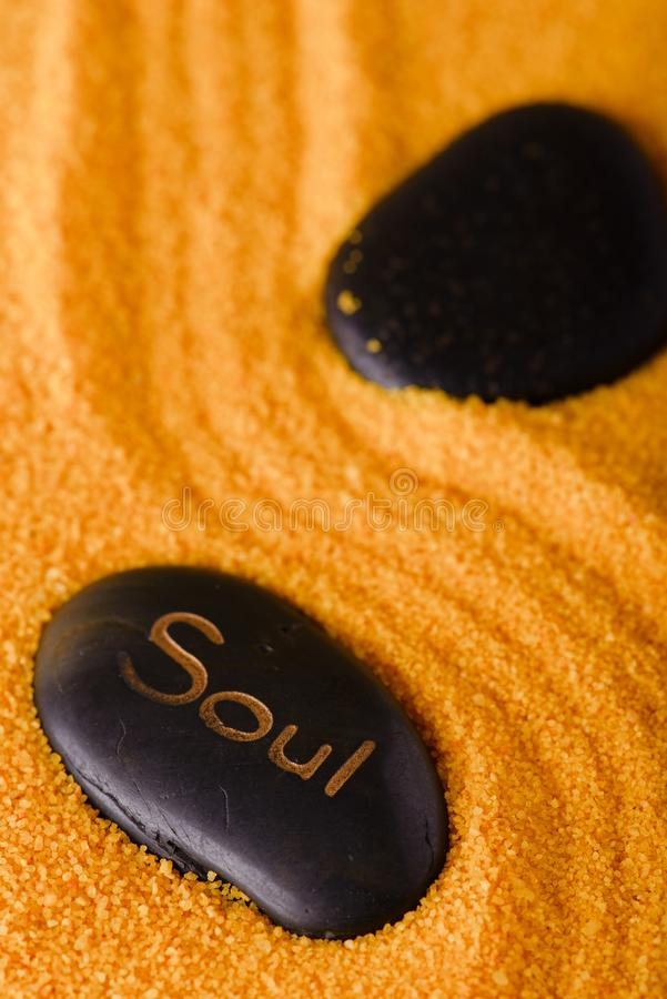 Lava stone with lettering Soul in sand royalty free stock photo