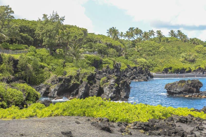 Lava vaggar kusten av Maui, väg till Hana, Hawaii arkivbilder