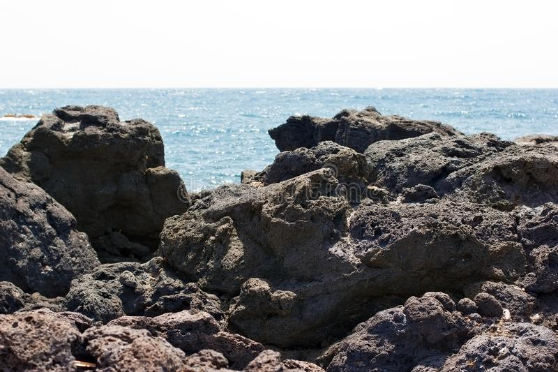 Lava, volcanic lava on beach of Sicily island - beautiful nature stock images
