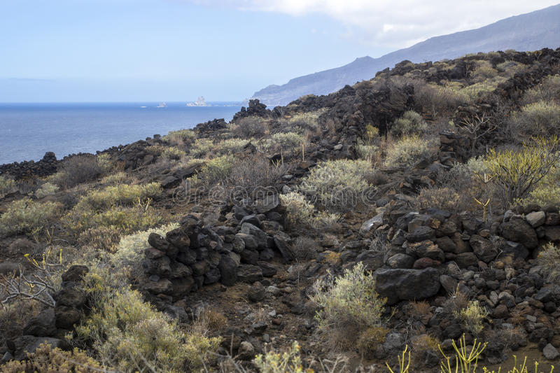 Lava walls with a view. Lava walls at the coast of El Golfo, El Hierro, Canary Islands, Spain royalty free stock images