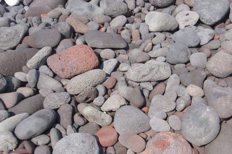 Lavafelsen, aufgerundet durch den Ozean lizenzfreie stockfotos
