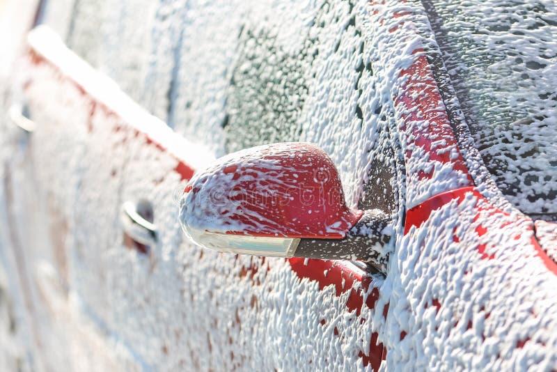 Lavagem de carros com sabão fotografia de stock royalty free