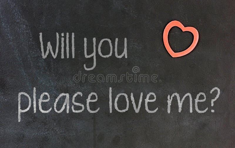 Lavagna con piccolo cuore rosso - prego mi amate immagini stock libere da diritti
