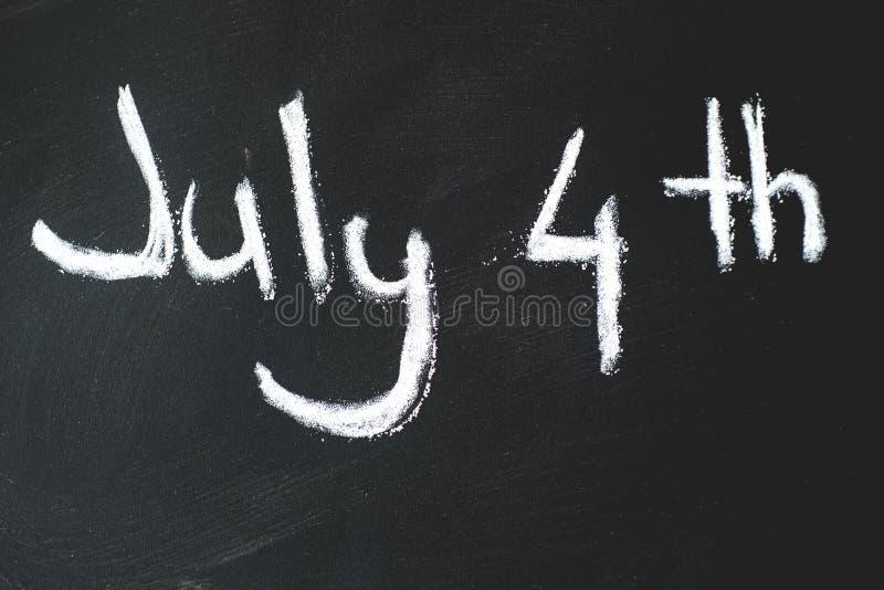 Lavagna nera in aula il quarto luglio fotografia stock