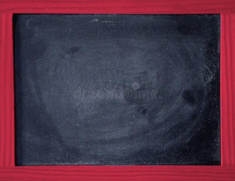 Lavagna nera con la struttura di legno rossa immagine stock libera da diritti