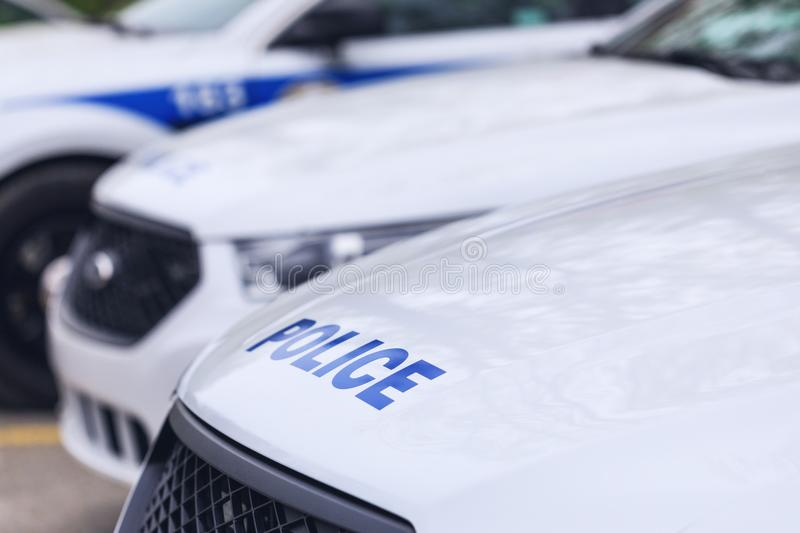 Laval, Canada: May 19, 2018: The car of the Canadian police. Ins. Cription on the car – Police. A police car in first plan with other police cars on stock photos