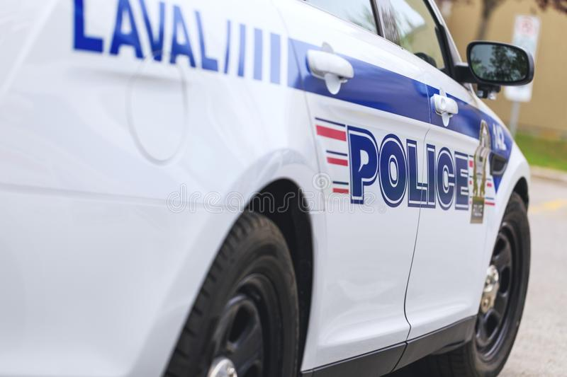 Laval, Canada: May 19, 2018. A real police car of the municipal. Police department in Laval town, during operative intervention. Inscriptions on the car stock photography