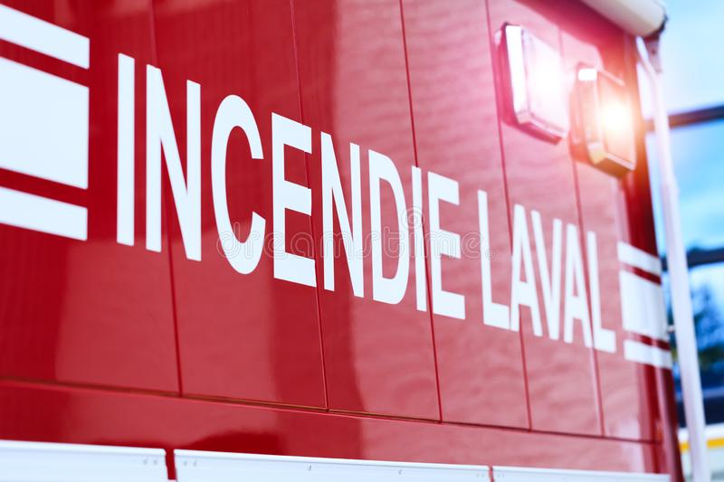 Laval, Canada: October 13, 2018: French inscription on the car. – Incendie Laval. The car of the Canadian Fire Department from Laval. Fire extinguishers royalty free stock image