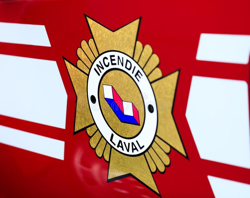 Laval, Canada: October 13, 2018: French inscription on the fire. Truck – Incendie Laval. The logo of the Canadian Fire Department from Laval. Fire royalty free stock photo