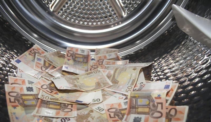 Lavare e di soldi immagine stock