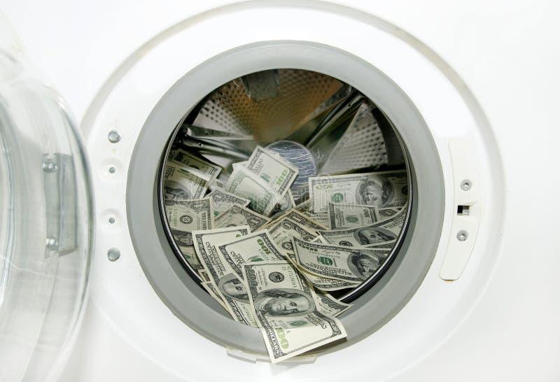 Lavatrice e dollari fotografia stock libera da diritti