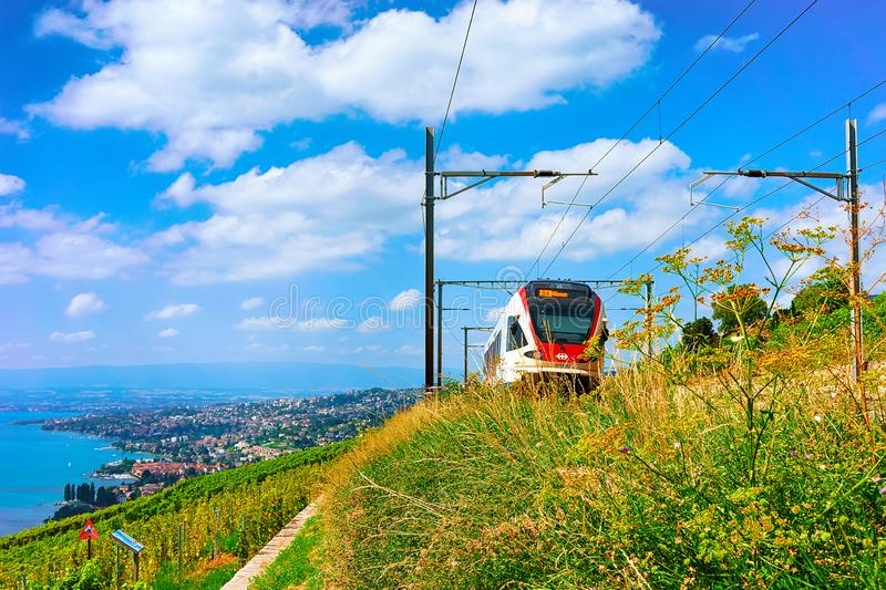 Lavaux, Switzerland - August 30, 2016: Running train in Lavaux Vineyard Terraces hiking trail at Lake Geneva and Swiss mountains,. Lavaux-Oron district royalty free stock images