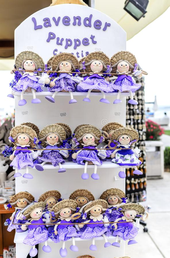Lavendeldockor croatia souvenir arkivfoton