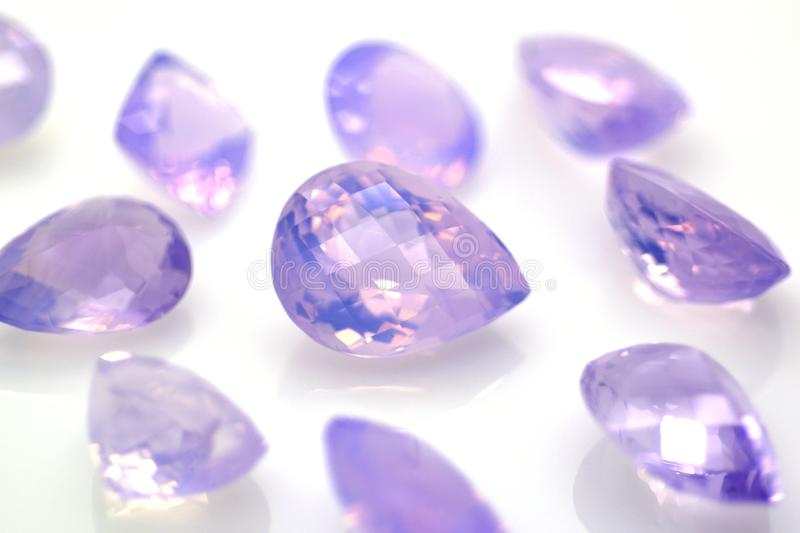 Lavender amethyst gems polished. Precious stones and jewelry stock image