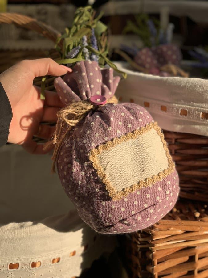 Lavender bag in female hands. stock photos