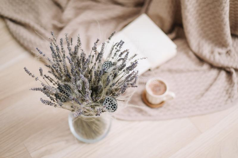Lavender bouquet with book and cup of coffee on wooden background. spring concept. top view. flatlay. Lavender bouquet with book and cup of coffee on wooden royalty free stock photography
