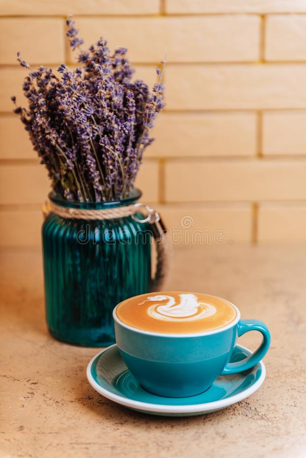 Lavender with coffee on light background royalty free stock photo