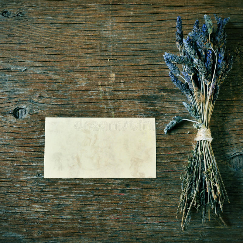 Lavender flowers and blank signboard on a rustic table stock image
