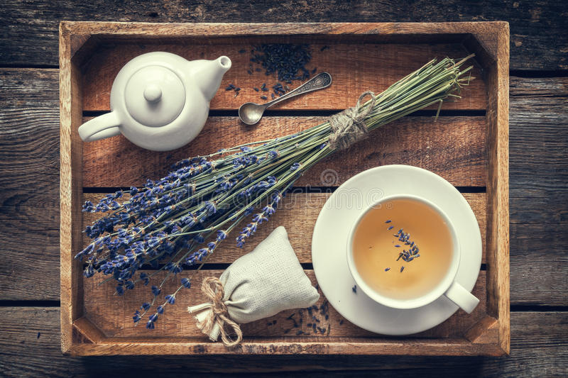 Lavender flowers, healthy tea in cup, teapot and sachet royalty free stock photos