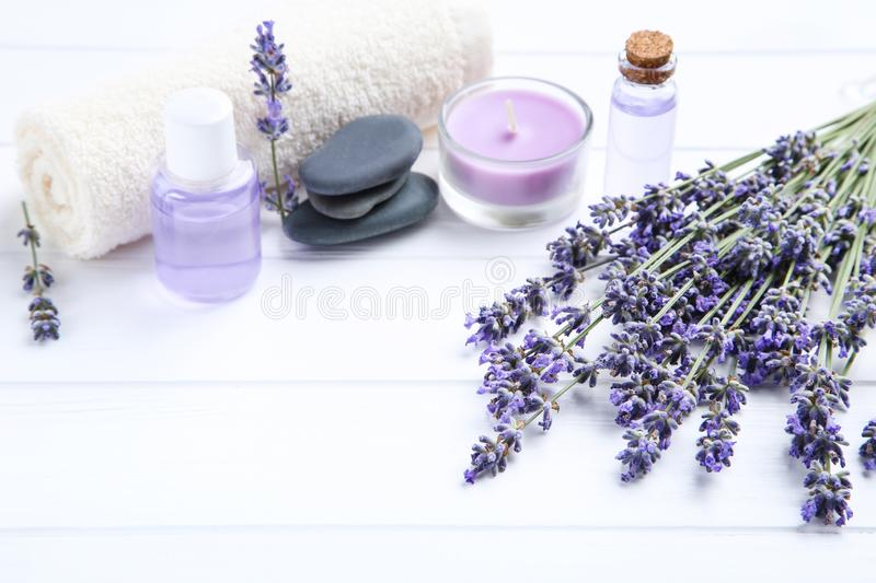 Lavender flowers with oil in bottles royalty free stock image