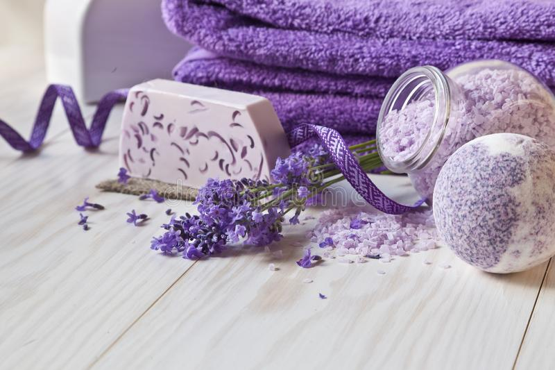 Lavender flowers, soap, aromatic sea salt and towels. Concept for spa, beauty and health salon, cosmetics store. Natural cosmetics stock photo