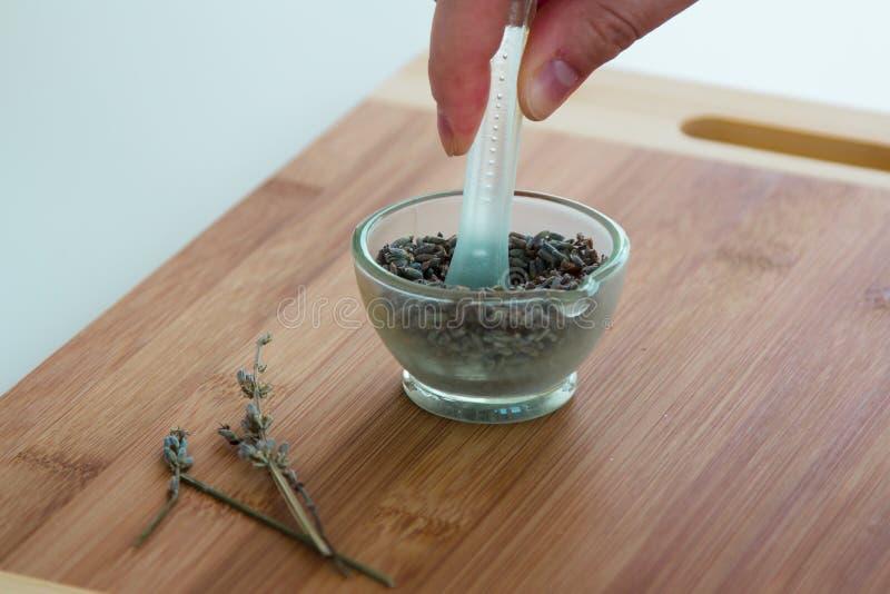 Lavender and lemon bath salt set. Preparation of lavender and lemon bath salt recipe. Crush the lavender seeds slightly in a pestle and mortar step. Ingredients royalty free stock photography