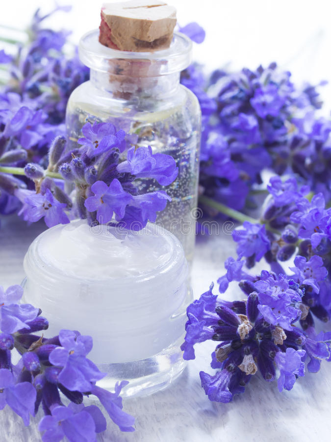 Lavender natural cosmetics. With beautiful fresh flowers on the table stock image