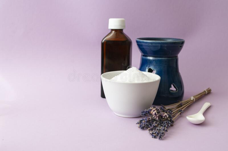 Lavender oil, aroma lamp, herbal flowers, scrub salt. Aromatherapy bath, relaxing at home. Natural skin care royalty free stock photos