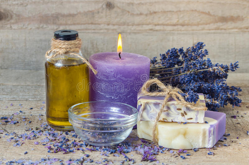 Lavender oil, lavender flowers, handmade soap and sea salt with royalty free stock images