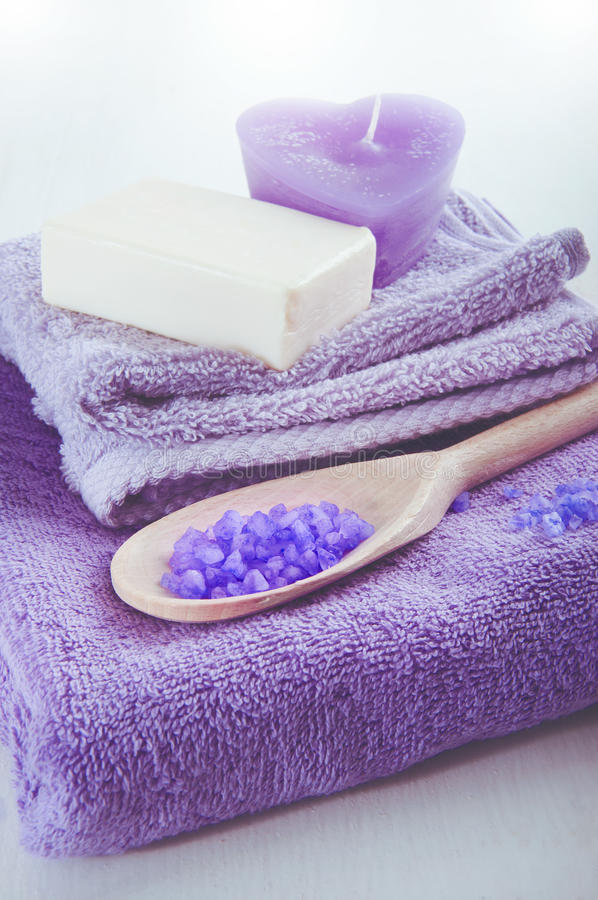 Lavender scented purple bath salt in a wooden spoon royalty free stock images