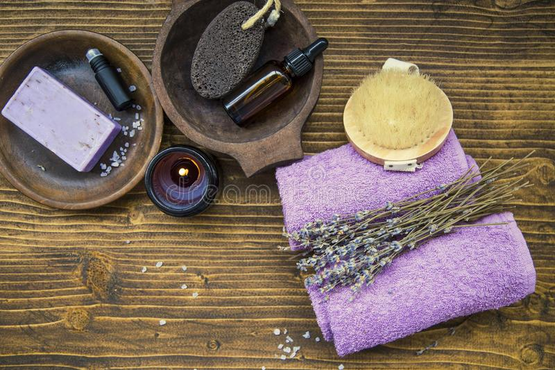 Lavender spa composition, home spa day with lavender products, top view of spa still life towels, lavender oil, natural soap, bath. Home spa day with lavender stock photo