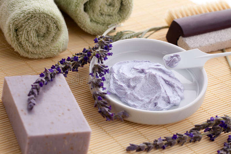 Lavender spa set. Spa set - fresh lavender, organic lavender scrub and soap on bamboo mat. Best suited for relaxing and health commercials royalty free stock photo