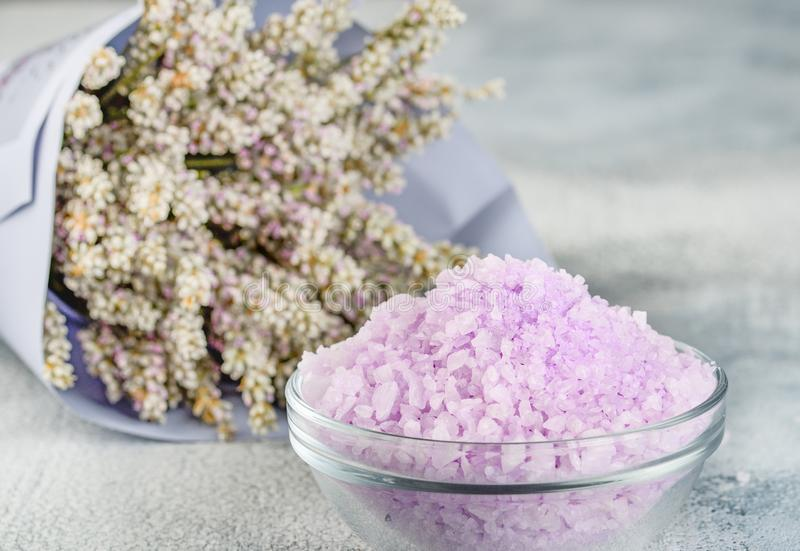 Lavender spa setting: salt, essential oil and dried flowers natural spa products and decor for bath on light background royalty free stock image