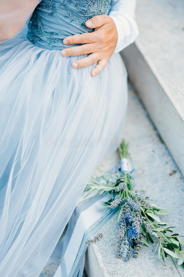 Lavender Wedding Bouquet Lies On The Stairs Next To The Bride An ...