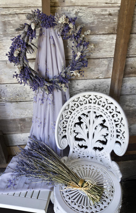 Free Lavender Wreath With White Wrought Iron Chair And Dried Lavender Stock Images - 42278264