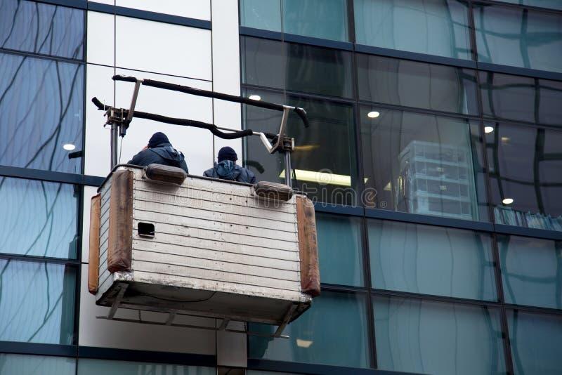 Laveurs de vitres images stock