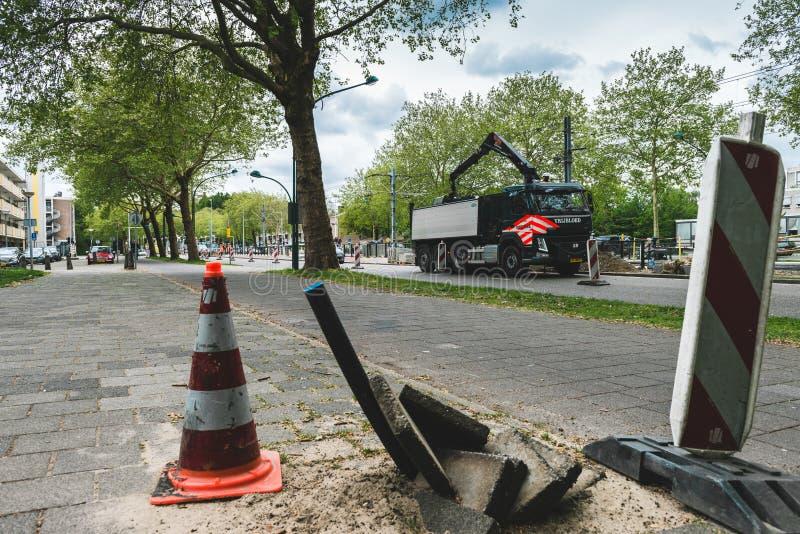 Lavorando alla strada Amsterdam Buitenveldert fotografia stock
