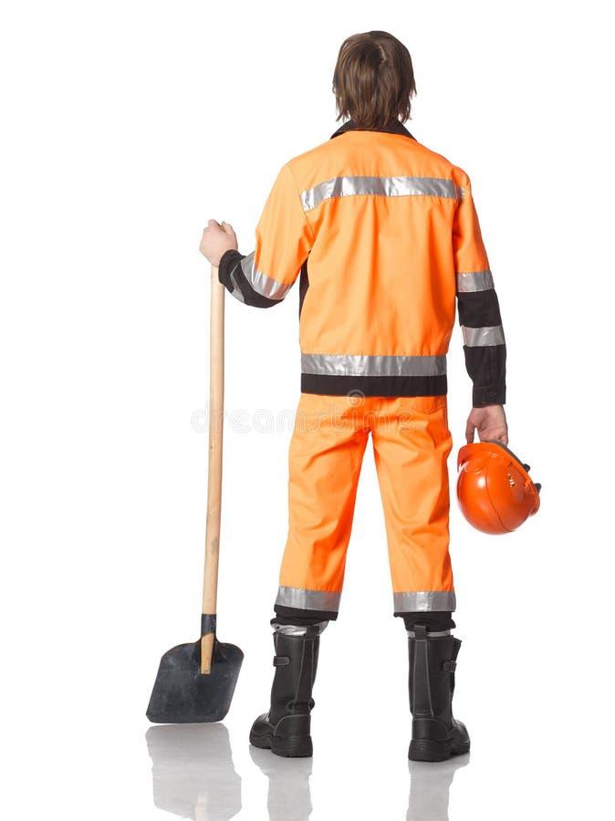 Lavoratore professionista della strada o del costruttore con il casco nelle mani ed nella sua fotografia stock