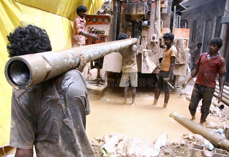 Lavoratori al cantiere, Delhi fotografie stock