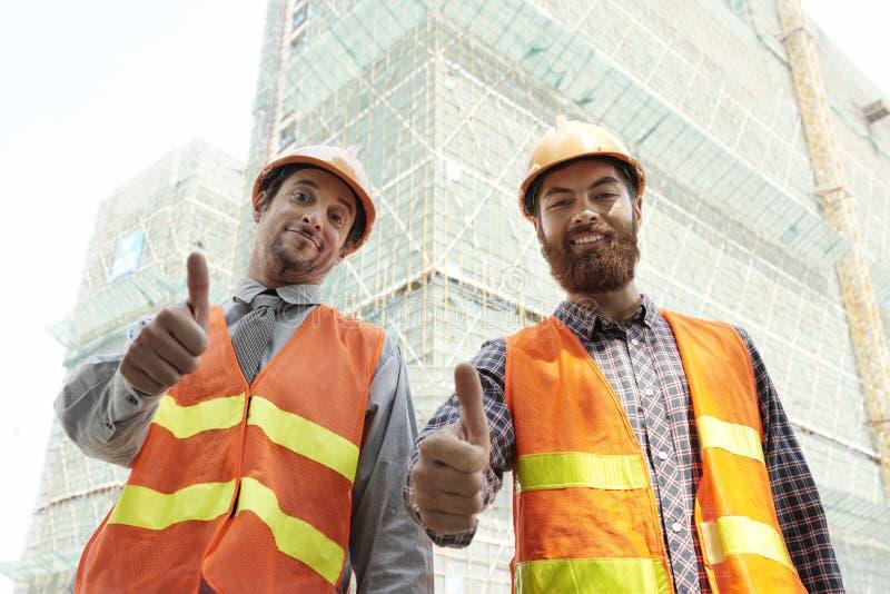 Lavoratori felici del cantiere immagini stock