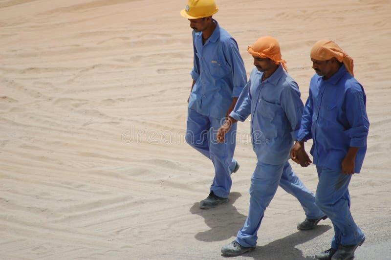 Lavoratori nel Dubai fotografie stock libere da diritti
